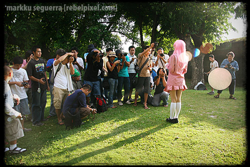 Photographers in action. [3]