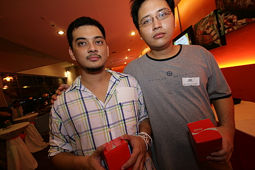 Jayvee and Rico look gloomy with their free coke glasses.