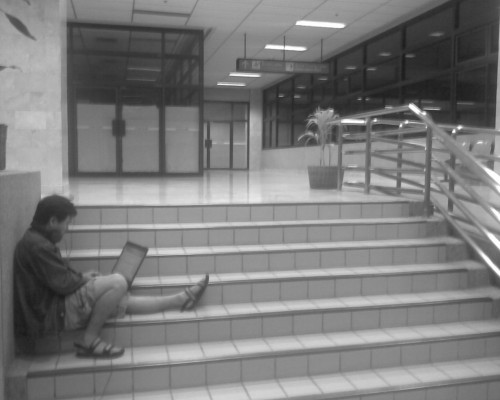 Web browsing at Mactan airport, stuck to an outlet just behind the garbage bins. Web addict!