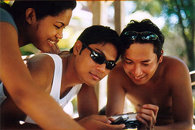 Arvi, Ado & Joey viewing photos on the digicam.