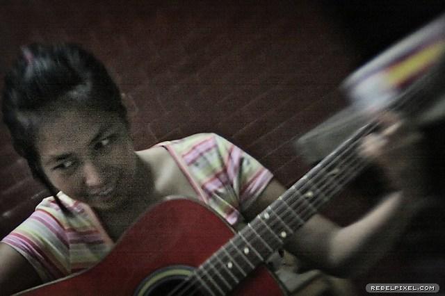 Mic, pretending to play the guitar.