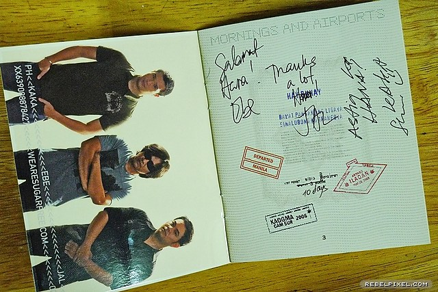 Our signed passport-inspired CD insert.
