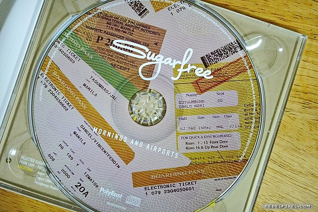 The album CD designed with airline boarding pass images.
